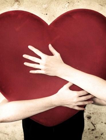 woman holding huge heart