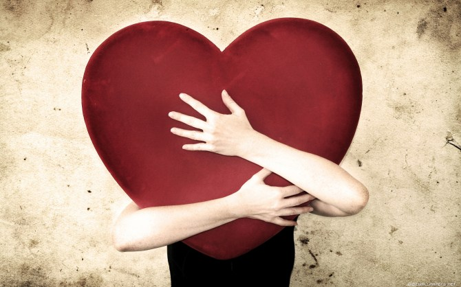 woman holding huge heart