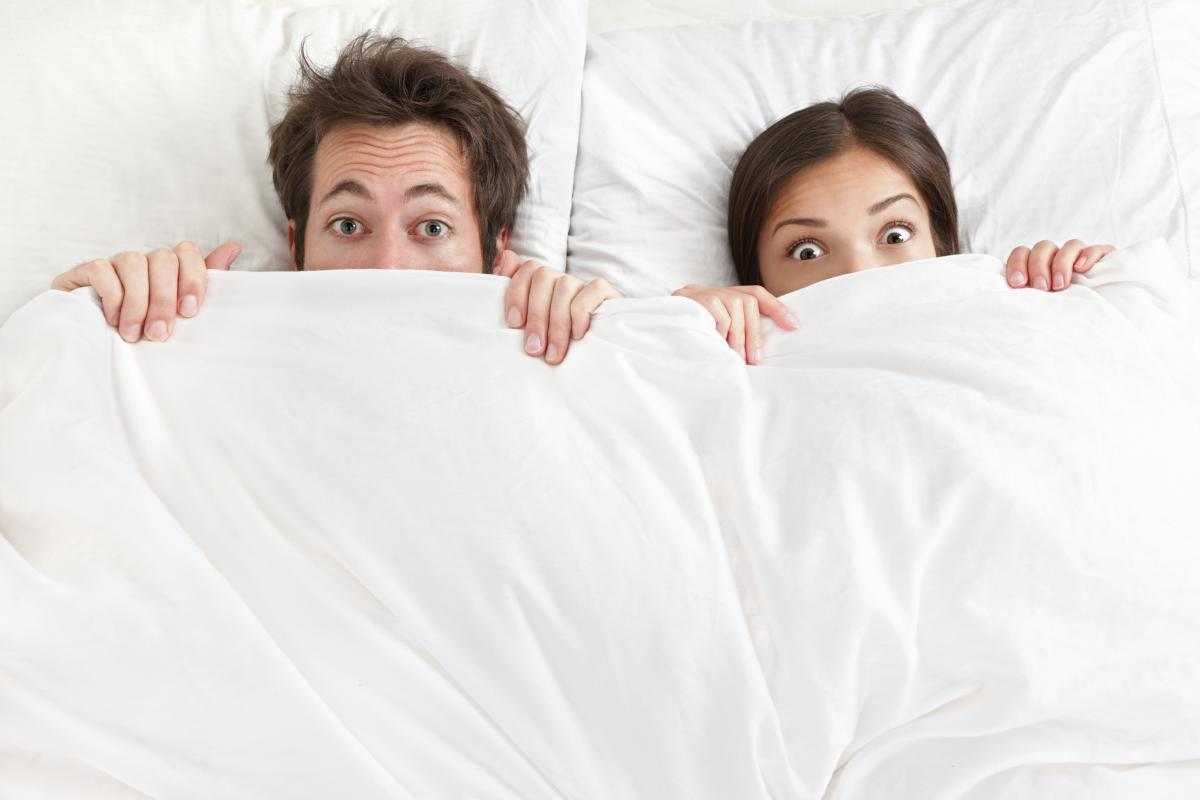 Man and woman in bed sleep