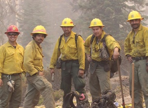 A fire crew stands ready on the Rim Fire in California.