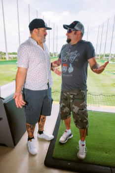 Joey Fatone and Chris Kirkpatrick poke fun at one another during the 14th Annual Irie Weekend Triller Celebrity Golf Tournament powered by South Florida Ford.