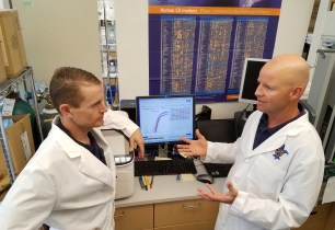Fran Sverdrup and colleague in his lab.