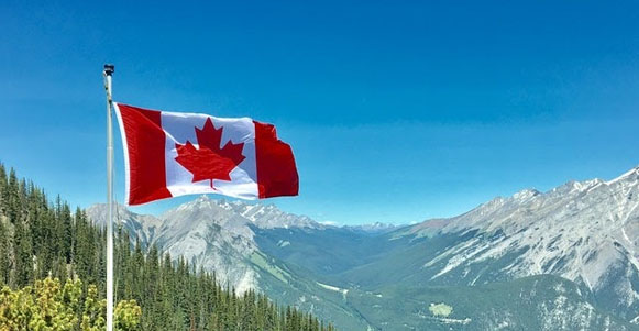 Canadian flag amidst a beautiful landscape