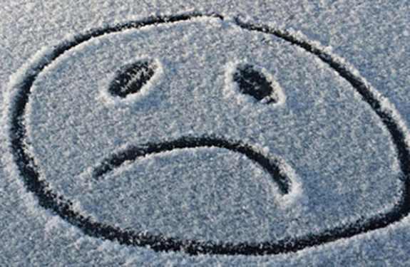Trauriger Smiley im Schnee