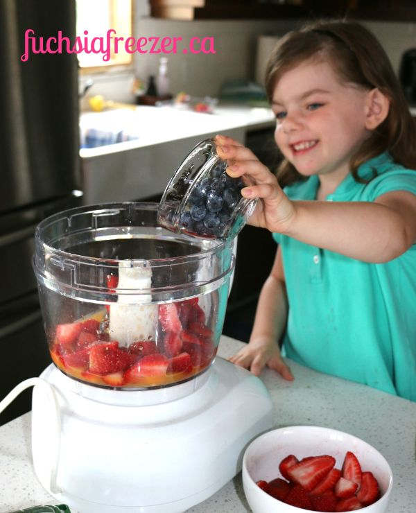 Audrey adding blueberries