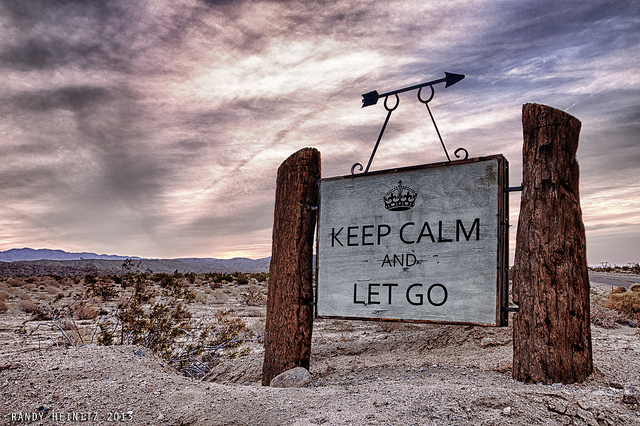 sign on beach, saying KEEP CALM AND LET GO