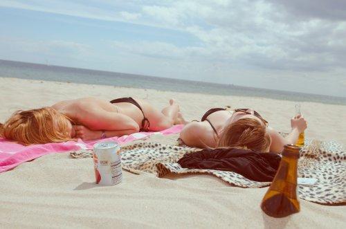 women on the beach side