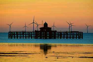 HERNE BAY Lu Dunne: 2nd Place Most sunset shots become all about the sky colour but this has interesting silhouetted shapes, almost symmetrical, together with the reflection which lift it.