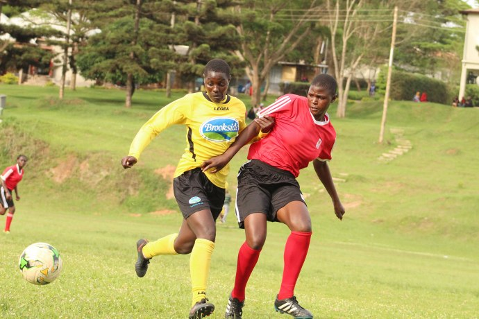 Crested Cranes Defender Nankya Shadia(Red) takes on Kawempe Muslim Player during a build up match in march 2018