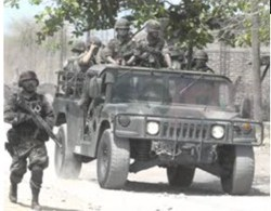 Mexican soldiers on jeep