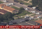 Chicago police officer and two federal agents were shot