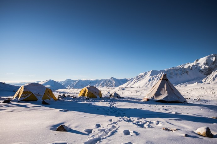Khuiten base camp.Of season, the camp is empty. We are the only ones there. Two tents are for us and one is a kitchen tent. Weather is bad today and we are waiting for some improvement so we can resume our summit bid.