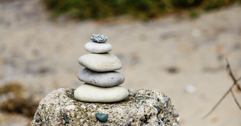 Parenthood 2.0 personal growth with bunch of rocks stacked together