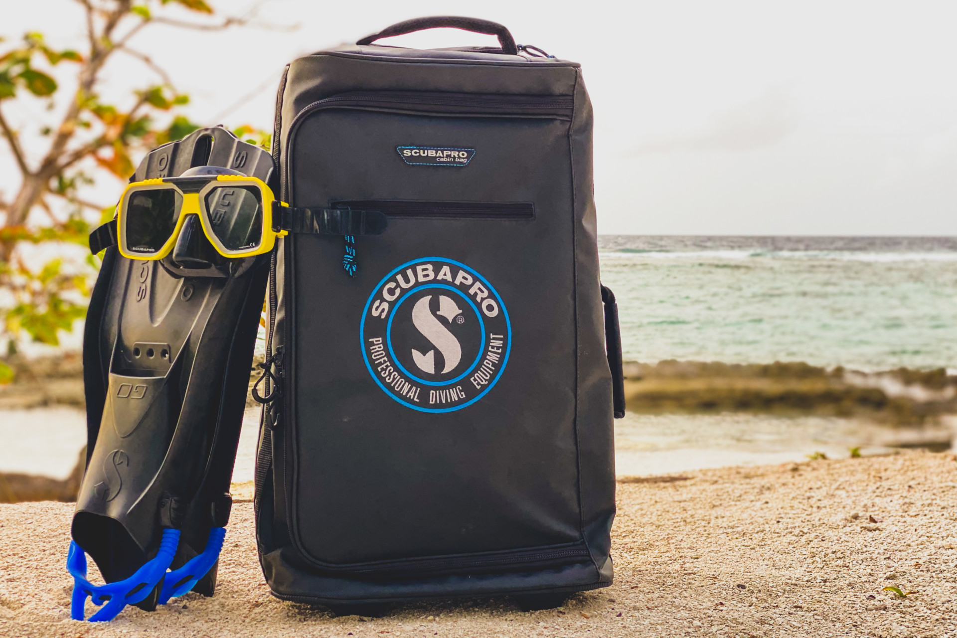 scubapro luggage at the beach in maldives
