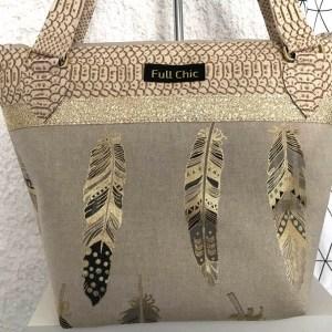 sac t plumes dorées
