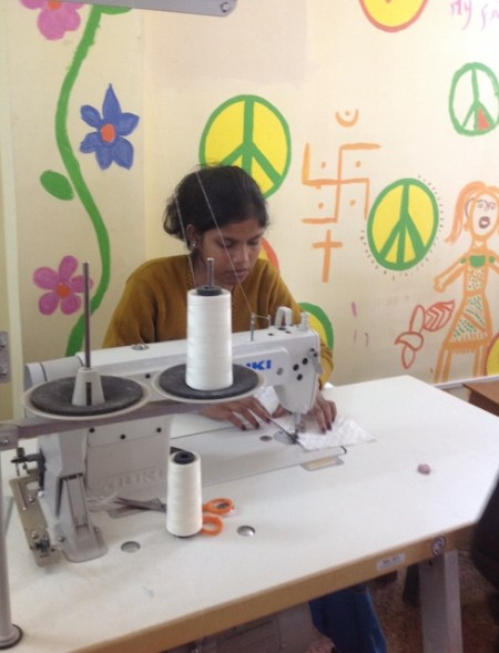 One of the girls sewing at the Women's Interlink Foundation in Kolkata, India
