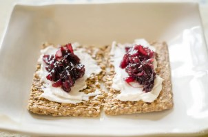 vegan red onion jam on crackers and cheese