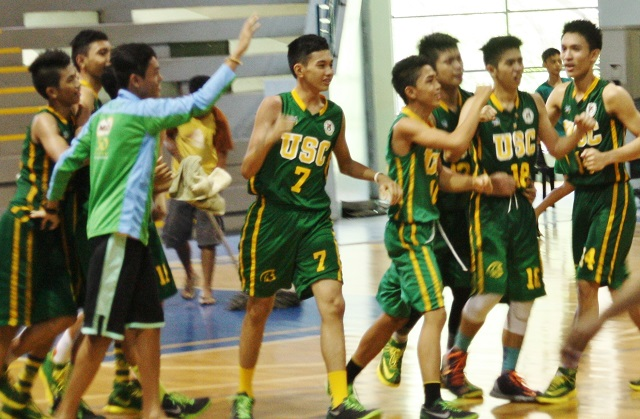 Team Visayas (University of San Carlos) celebrates after clinching the secondary basketball title by surviving Luzon, 55-53.