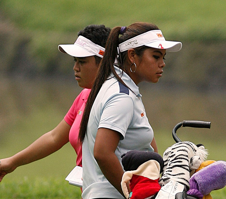 Dottie Ardina (right) and Lovelynn Guioguio go separate ways after reaching the green on No. 2.