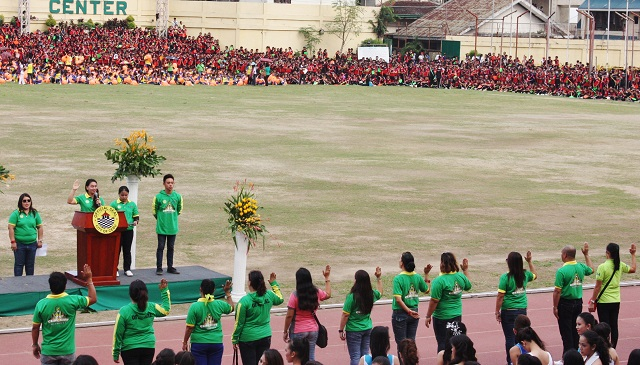 Dr. Juvelyn Otero, tournament manager of the Folk Dance, leads the Oath of Officiating Officials during the opening ceremonies of the 24th Cebu City Olympics.