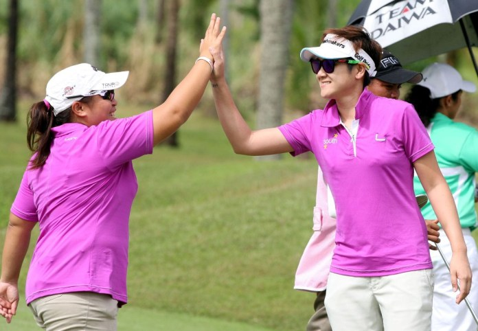 Team South's Barsy Leonen (left) gets a high five from Anya Tanpinco after winning their match in the first Duel – North vs South at Cangolf.