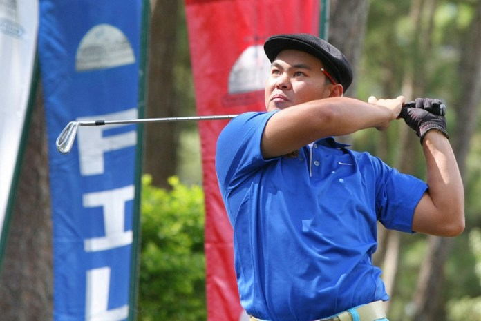 Southwoods' Chepe Dulay hits a tee-shot during the third round of the 65th San Miguel Fil-Am Invitational golf tournament.