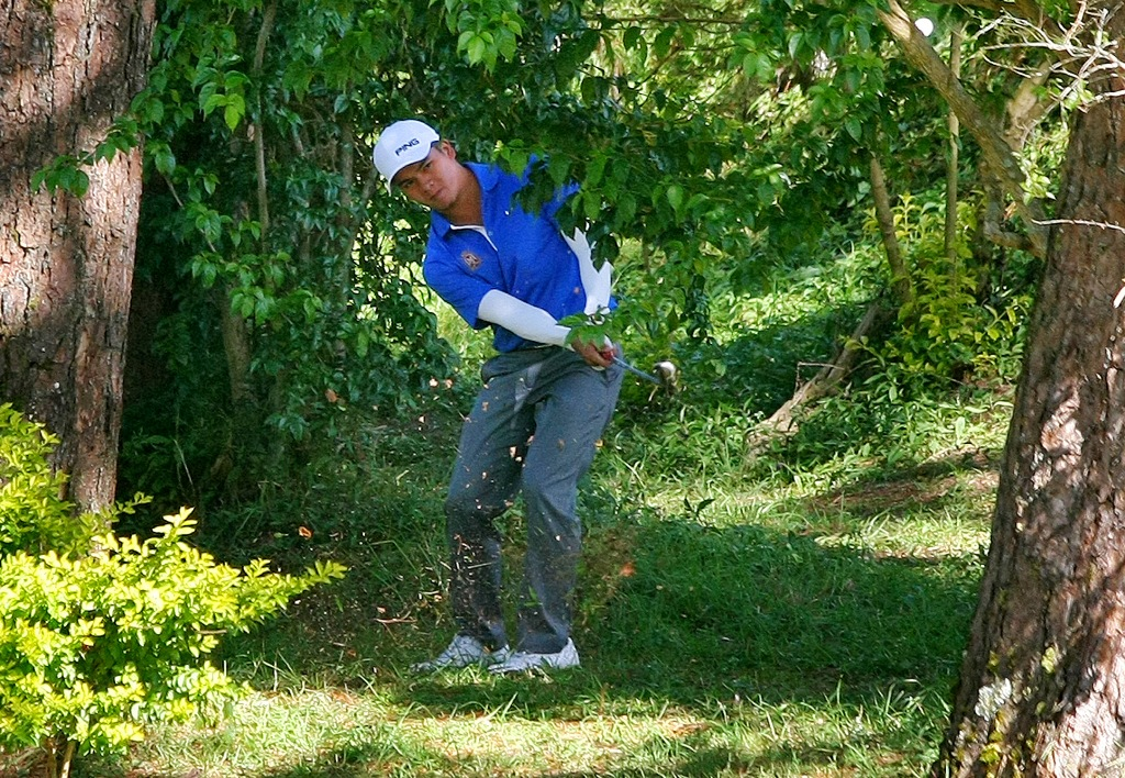 Southwoods ace Justin Quiban plays out of a troubled lie in the third round of the 65th San Miguel Fil-Am Invitational golf tournament.