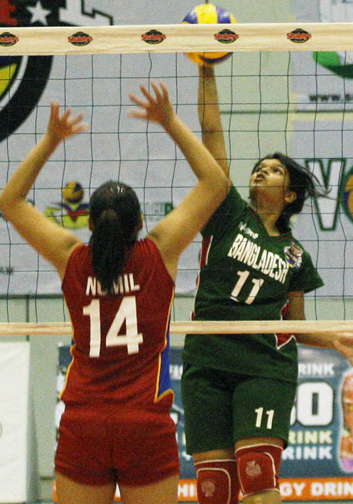 Hilton Norma (11) of Bangladesh goes up for a smash against NCR's Ferlyn Nomil during their Shakey's GVL Season 12 duel at the Ynares Sports Arena Thursday. The Big City bets, represented by National U, won in two.