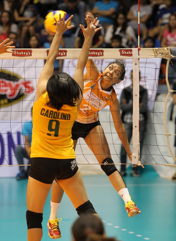 PLDT's Alyssa Valdez smashes one against Army's Michelle Carolino during their Shakey's V-League Open Conference duel at The Arena.