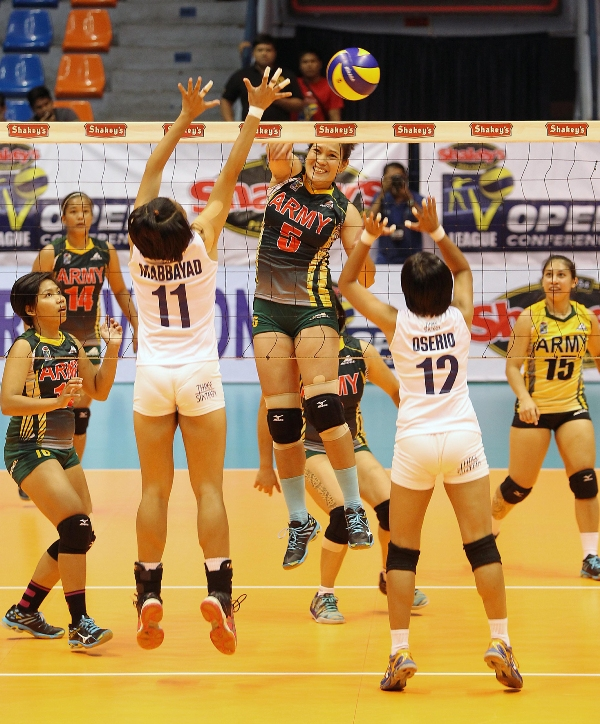 Army's Mary Jean Balse fires away a smash against Navy's Lilet Mabbayad and Lou Oserio during their Shakey's V-League Open Conference duel at The Arena.
