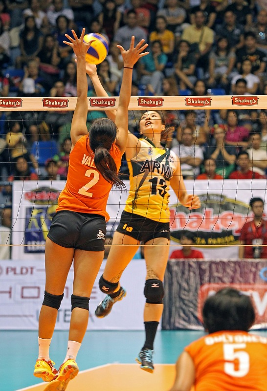 Army's Rachel Ann Daquis goes for a power tip against PLDT's Alyssa Valdez during their Shakey's V-League Open Conference duel at The Arena.