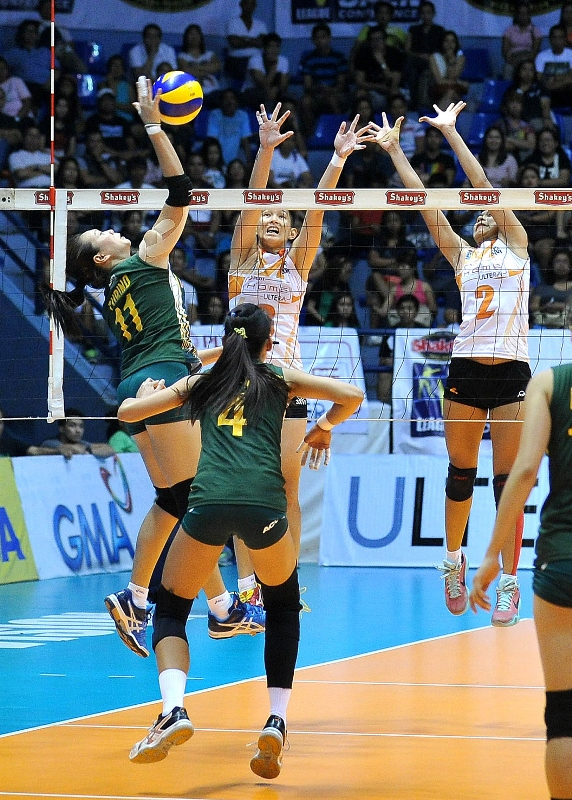 Army's Honey Royse Tubino goes for a kill against PLDT's Sue Roces and Alyssa Valdez during their semis clash in the Shakey's V-League Season 12 Open Conference.