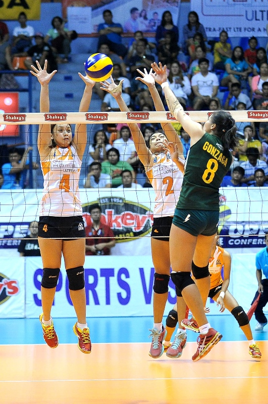 Jovelyn Gonzaga of Army unleashes a kill against Rysabelle Devanadera (4) and Alyssa Valdez (2) of PLDT during their semis clash in the Shakey's V-League Season 12 Open Conference.
