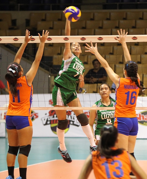 Southern Luzon's Jewel Encarnacion (1) soars for a kill over Central Visayas' Christine Vergara (11) and Paula Maninang during the opener of the Shakey's Girls' Volleyball League national finals at the Astrodome last Monday.
