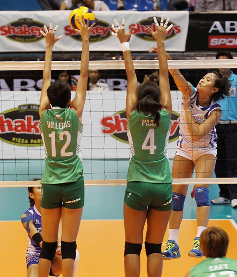Cebuana Gretchel Soltones of BaliPure (right) defies Laoag's Katherine Villegas and Mylene Paat's defense as she fires away a kill during their Shakey's V-League encounter.