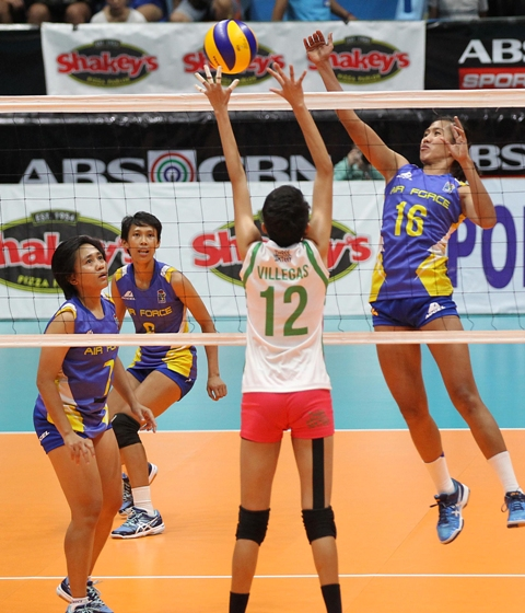 Air Force's Angel Antipuesto (16) cashes in on Laoag's single blocker in Katherine Villegas for a hit during Game One of their best-of-three semifinal series in the Shakey's V-League.
