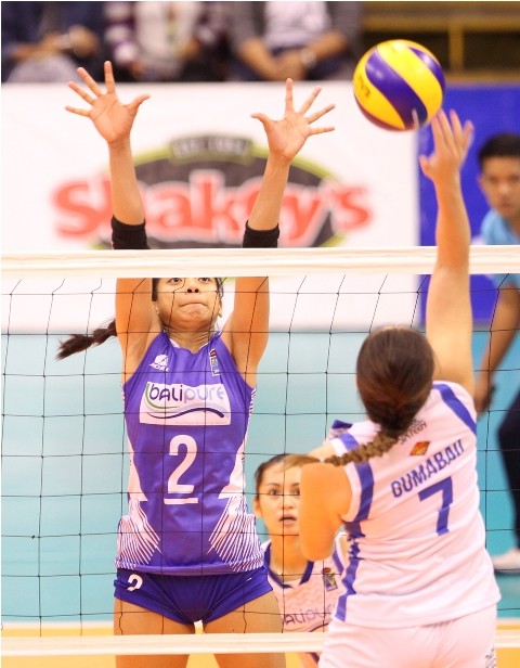 Pocari Sweat's Michelle Gumabao (7) goes for a kill against BaliPure's Alyssa Valdez during their sudden death for the second finals berth in the Shakey's V-League Season 13 Open Conference.