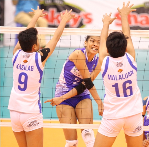 BaliPure's ace hitter Alyssa Valdez (2) reacts after hammering in a kill against Pocari Sweat's Elaine Kasilag and Lutgarda Malaluan during their sudden death for the second finals berth in the Shakey's V-League Season 13 Open Conference.