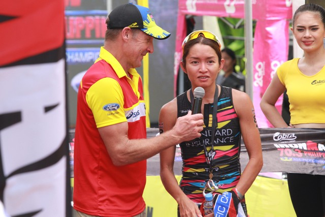 Monica Torres is interviewed after crossing the finish line as champion of the Filipino Women elite class. (NIMROD NL QUIÑONES)
