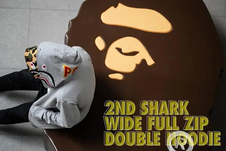 A BATHING APEから2NDバージョンのシャークフルジップフーディのフーディ部分を重ねダブルフーディに仕上げた「2ND SHARK WIDE FULL ZIP DOUBLE HOODIEP」が7/7発売 (ア ベイシング エイプ)