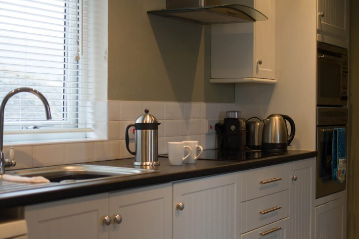 Photo of Poppies Cottage. Kitchen worktop with coffee cups and kettle