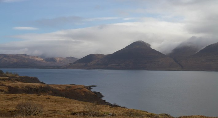 View of loch na keal, mountains on the one side shrouded in cloud