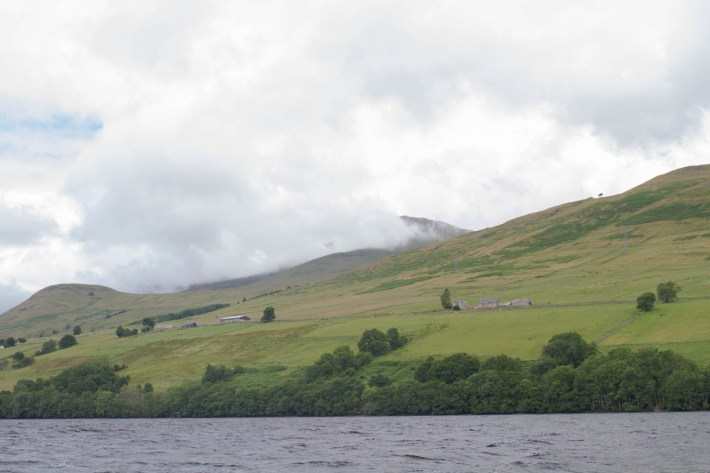 Loch Tay Safaris, Kenmore, Perthshire. A view from the water up the hillside. Low cloud over the hills