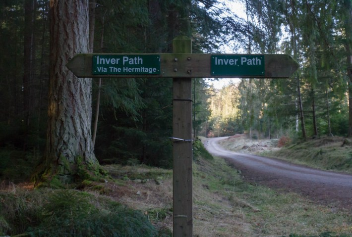 A sign post in woodland for the Inver Path