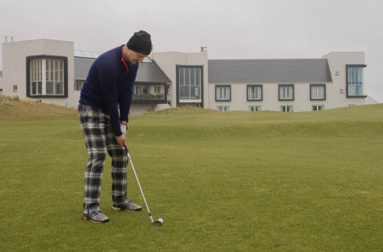 Man playing golf on the Machrie Links golf course