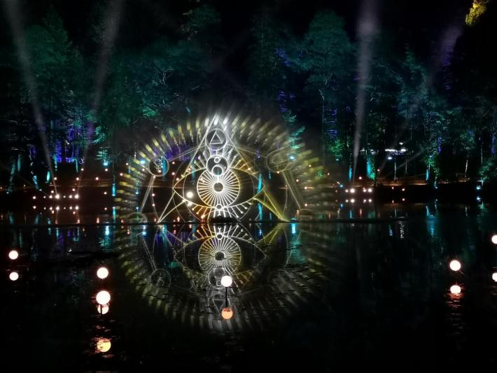 Enchanted Forest. Light display over the loch