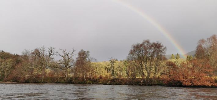 Photo of a rainbow above the river Tummel