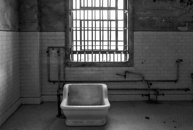 black and white photograph of hip bath in Alcatraz hydro-therapy room