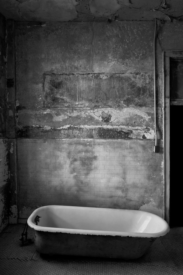 Black and white photograph of old enamel bath in hydro-therapy room Alcatraz