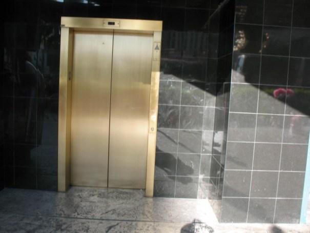 Elevator door leading to timeshare sales office.